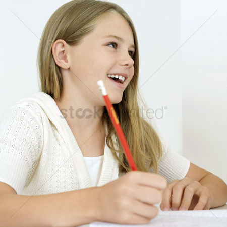 Learning : Girl smiling while writing
