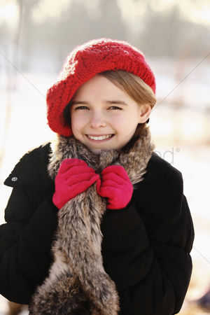 Cold temperature : Girl with red hat and glove  smiling