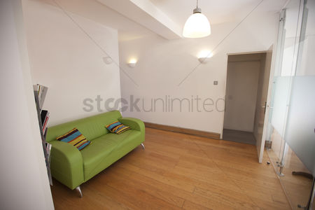 Furniture : Green sofa in empty office