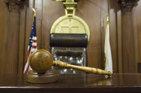 Flag : Hammer and gavel near judges chair in court