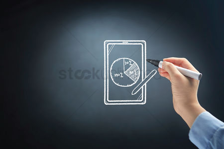 Applications : Hand drawing business pie chart on tablet pc display