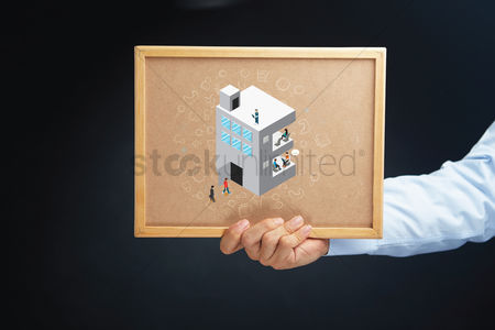Cork board : Hand holding a board with isometric alphabet e