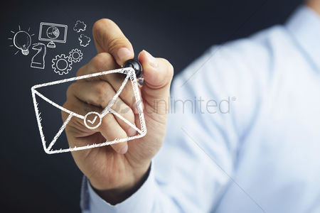 Match : Hand holding a marker pen with business mail concept