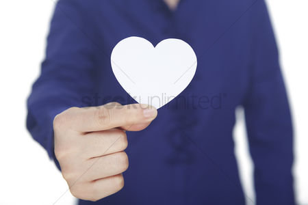 Heart shapes : Hand holding a paper heart