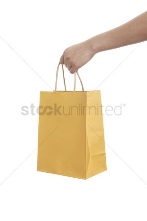 Shopping background : Hand holding a shopping bag