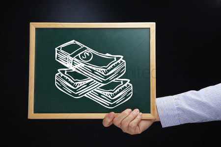 Handdrawn : Hand holding blackboard with stack of cash concept