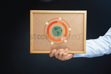 Cork board : Hand holding board with international ring chart