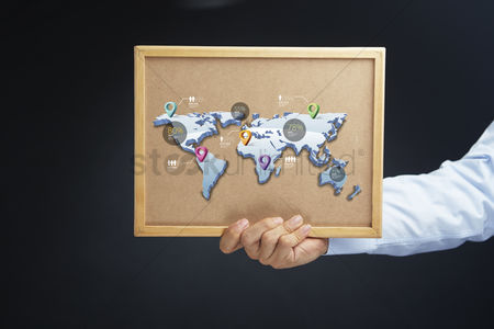 Cork board : Hand holding cork board with global business concept