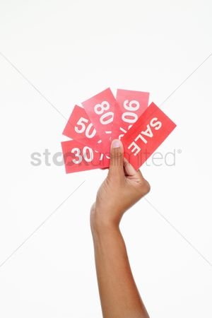 Shopping background : Hand holding sale signs