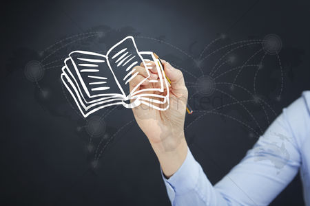 Notebook : Hand illustrating an open book