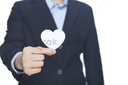 Heart shapes : Hand offering a heart shaped paper