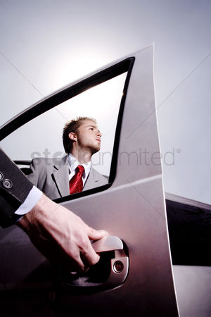 Transportation : Hand opening car door for a businessman