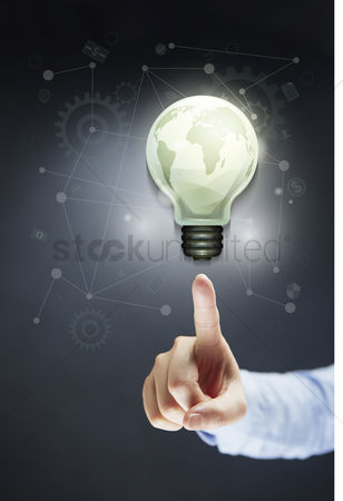 Earth  graphic vector : Hand pointing at light bulb with globe concept