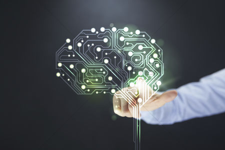 Conceptual : Hand pointing towards brain with circuit board design