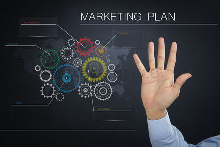 Business : Hand presenting a business marketing plan concept