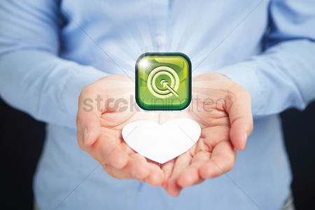 Heart shapes : Hand presenting business target button concept