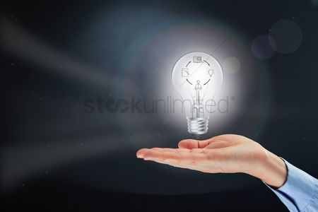 Thought : Hand presenting light bulb with creative process concept