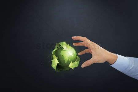 Try : Hand reaching out towards global environmental concept