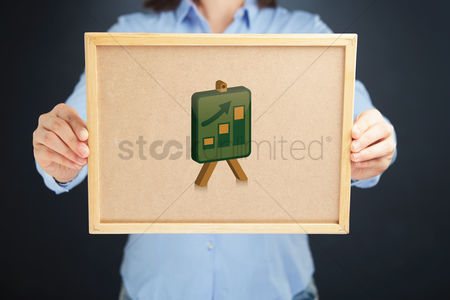 Cork board : Hands holding a board with bar charts