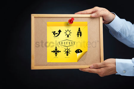 Cork board : Hands holding a board with steps to be successful