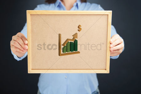 Applications : Hands holding a board with stock exchange icon