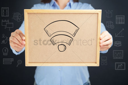 Handdrawn : Hands holding a cork board with wireless signal sign