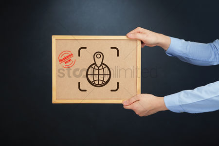 Cork board : Hands holding board with a location indicator icon