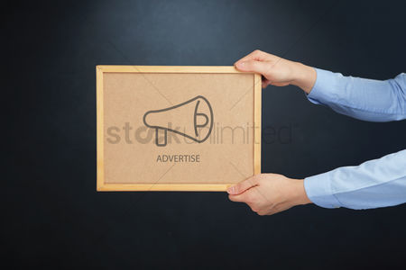 Cork board : Hands holding board with advertise concept