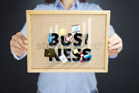 Instruction : Hands holding board with business concept