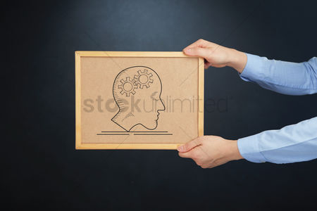 Cork board : Hands holding cork board with business mind concept