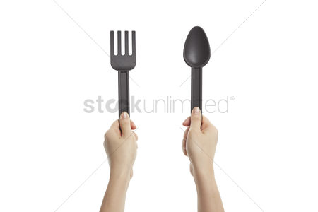 Grasp : Hands holding disposable fork and spoon