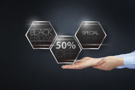 Hexagon : Hands presenting black friday sale