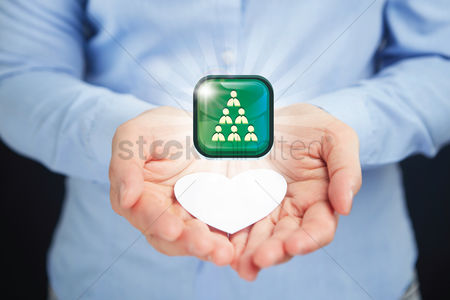 Heart shapes : Hands presenting corporate icon