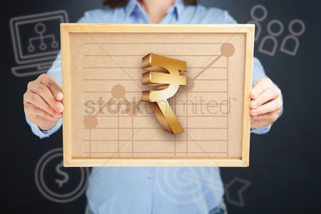 Cork board : Hands presenting indian rupee currency chart on cork board concept