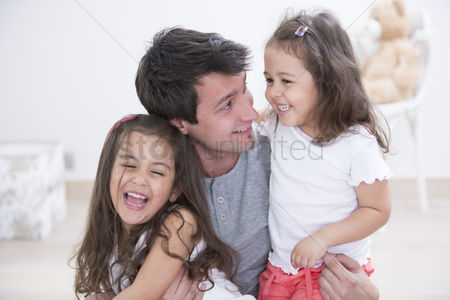 Czech republic : Happy father with daughters spending quality time together at home