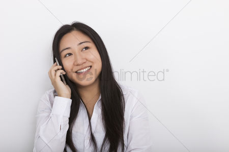Technology background : Happy woman answering cell phone against white background