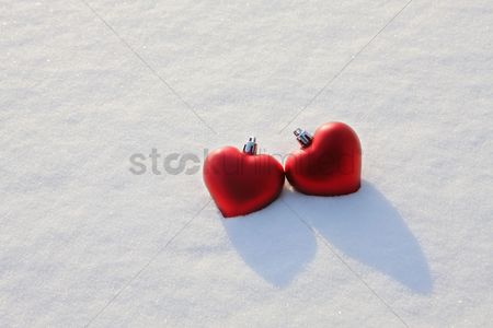 Two people : Heart-shaped christmas baubles