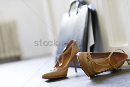 Interior : High heels and briefcase on domestic hallway floor close up