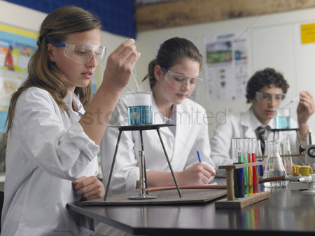 Young boy : High school students studying in laboratory