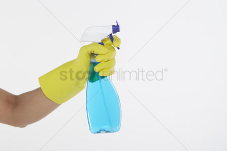 Hand : Human hand holding a spray bottle