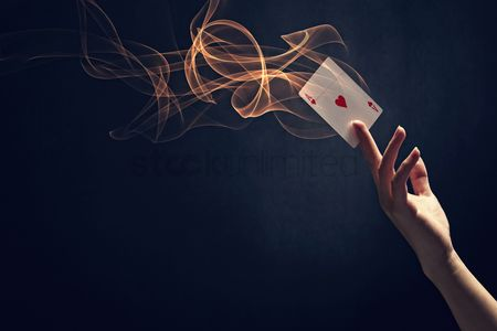 Black background : Human hand holding up an ace of hearts