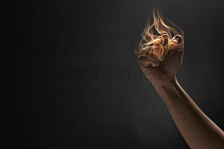 Black background : Human hand showing a punching gesture