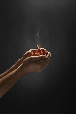 Malay : Human hands holding fire