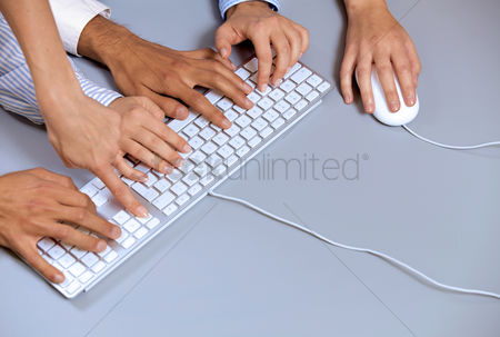 Body : Human hands on computer keyboard with one hand using computer mouse