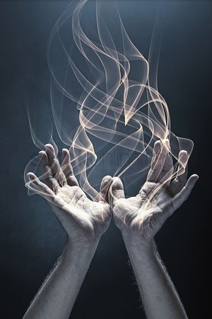 Creativity : Human hands with fire coming out of it