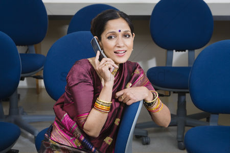 Traditional clothing : Indian businesswoman using cell phone