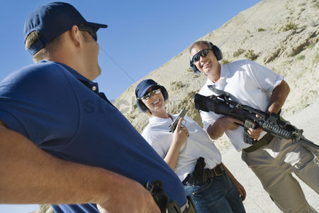 Firing : Instructor with couple at firing range in desert
