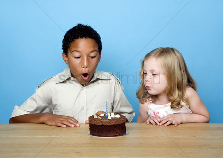 Celebration : Kids blowing the candles on the birthday cake