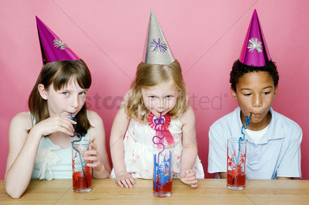 Refreshment : Kids with party hats drinking