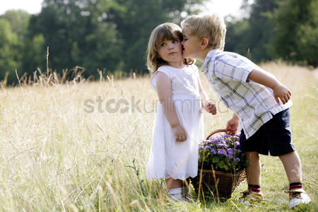 Smiling : Little boy kissing little girl